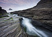Water eroded slate beds at Trebarwith Strand in North Cornwall, England, United Kingdom, Europe