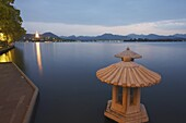 Xi Hu (West Lake) at dusk with Jinci Si Pagoda in background, Hangzhou, Zhejiang, China, Asia