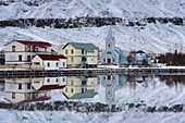 Traditional wooden church, built in 1922, at Seydisfjordur, a town founded in 1895 by a Norwegian fishing company, now main ferry port to and from Europe in the East Fjords, Iceland, Polar Regions