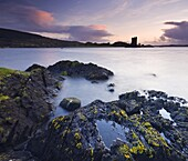 Twilight on the shores of Loch Linnhe near Appin, looking out towards the silhouette of Castle Stalker, Highlands, Scotland, United Kingdom, Europe