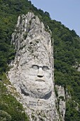 A rock sculpture of Decebalus, last prince of the Dracinians, on a hillside in the Kazan Gorge area of the Danube River, Romania, Europe