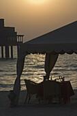 Table setting on the beach, Dubai, United Arab Emirates, Middle East