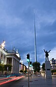 O'Connell Street, General Post Office, Monument of Light (The Spike), and Jim Larkin statue in the evening, Dublin, Republic of Ireland, Europe