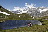Two hikers at Schwarzsee, Zermatt, Valais, Swiss Alps, Switzerland, Europe