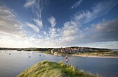 Alnmouth village and the Aln Estuary viewed from Church Hill on a calm late summer's evening with a dramatic sky overhead, Alnmouth near Alnwick, Northumberland, England, United Kingdom, Europe