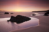 Rockpools on the sandy shores of Bedruthan Steps at sunset Cornwall, England, United Kingdom, Europe
