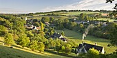 Cottages nestled into the valley in the picturesque Cotswolds village of Naunton, Gloucestershire, England, United Kingdom, Europe