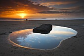 Rockpool and people at sunset, Dunraven Bay, Southerndown, Wales, United Kingdom, Europe
