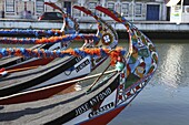 The prows of gondola-like Moliceiros, boats used to give tourists rides along the canals of Aveiro, Beira Litoral, Portugal