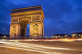 Traffic at the Arc de Triomphe at night, Paris, France, Europe