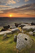 Sunset over millstones, Froggatt and Curbar Edge, Peak District National Park, Derbyshire, England, United Kingdom, Europe
