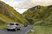 Cars travelling down Winnats Pass, Castleton, Peak District National Park, Derbyshire, England, United Kingdom, Europe