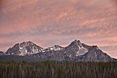 Pink sunset clouds over McGowen Peak on the right and Mt. Regan on the left, in the Sawtooth Range, Sawtooth National Recreation Area, Idaho, United States of America, North America