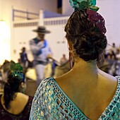Spanish girl watching horse-back feria procession, Tarifa, Andalucia, Spain, Europe