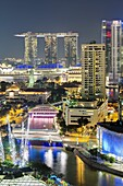Elevated view over the Entertainment district of Clarke Quay, the Singapore River and city skyline at night, Singapore, Southeast Asia, Asia
