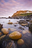 Cape Cornwall and the Sentinel from the rocky shores of Priests Cove, Cornwall, England, United Kingdom, Europe