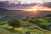 Sunrise over the Sugarloaf and town of Crickhowell, Brecon Beacons National Park, Powys, Wales, United Kingdom, Europe