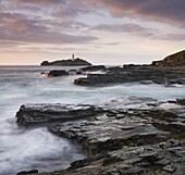 Godrevy Lighthouse off the rocky coast of Godrevy Point, Cornwall, England, United Kingdom, Europe