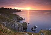 Spectacular sunrise behind Start Point Lighthouse in South Hams, Devon, England, United Kingdom, Europe