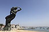 Nautical statue of a female figure looking towards the Atlantic Ocean at Ribeira Beach, Cascais, near Lisbon, Portugal, Europe