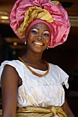 Portrait of a Bahian woman in traditional dress at the Pelourinho district, Salvador (Salvador de Bahia), Bahia, Brazil, South America