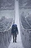 Footbridge, Dodh Kosi River, Khumbu (Everest) Region, Nepal, Himalayas, Asia