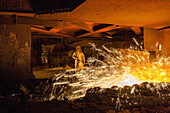 Salzgitter Steelworks, steel worker in protective suit, sparks, glowing heat, industry, Lower Saxony, Northern, Germany