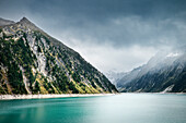 Turquoise glacial water at Schlegeis Dam, Zillertal, Tyrol, Austria, Alps