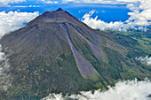 Aerial of volcano Montanha do Pico, Mount Pico with summit Pico Pequeno and crater above clouds, highest mountain of Portugal, stratovolcano, Island of Pico, Azores, Portugal, Europe, Atlantic Ocean