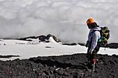 Mountain climber at volcano Villarrica, Strato volcano, sunset, National Park Villarrica, Pucon, Región de la Auracania, Region Los Rios,  Patagonia, Andes, Chile, South America