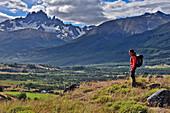 Young woman hiking at mountain range of Cerro Castillo, Carretera Austral, Región Aysén, Patagonia, Andes, Chile, South America