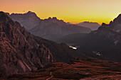 mountain ranges and peaks of Cadini di Misurina after sunset with moon, Val Pusteria Valley, Sesto, Dolomites, South Tyrol, Veneto, Alto Adige, Three Peaks (Tre Cime di Lavaredo) Nature Park, UNESCO world heritage side, Italy, European Alps, Europe