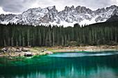 Karersee lake,  Lago di Carezza, with view to snow covered  Latemar, Lago di Carezza, valley Eggental, Val d´Ega, Dolomites, South Tyrol, Alto Adige, Trentino, UNESCO world heritage side, Italy, European Alps, Europe