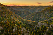 View from Roßtrappe to Bode Valley with rocks and colorful trees in autumn after sunset,  Thale, Harz Foreland, Harz Mountains, Saxony-Anhalt, Germany