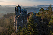 Wehlgrund valley with view to rock formations and mountains at sunset with fog, Neurathen Castle, Bastei, Rathen, Elbe Sandstone Mountains, Saxon Switzerland, Saxony, Germany