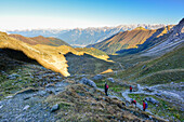 Hikers in morning light on hiking trail to Schlicker Seespitze and Gamskogel, Kalkkögel, Grinzens, Stubai valley, Hinteres Oberbergtal, Stubai Alps, Tyrol, Austria, European Alps, Europe