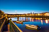 View across Rio Gilao towards old town at twilight, Tavira, Algarve, Portugal