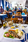 Grilled fish in a restaurant, Algarve, Portugal