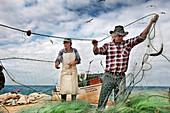 Fishermen on the beach, Armacao de Pera, Algarve, Portugal
