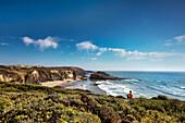 Man looking towards the beach, Zambujeira do Mar, Costa Vicentina, Alentejo, Portugal