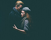 Couple wearing warm clothing hugging
