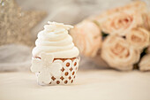 Close up of decorated cupcake with white icing