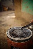 Freshly roasting coffee, Omorate, Omo Valley, Ethiopia, Africa