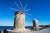 Medieval windmills at Mandraki harbour, City of Rhodes, Rhodes, Dodecanese Islands, Greek Islands, Greece, Europe