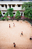 Locals play soccer on outdoor pitch, Siem Reap, Cambodia
