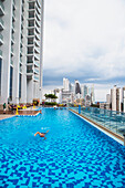A poolside view overlooking the newer side of the Panama City skyline, Panama City, Panama