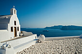White church on the water's edge, Oia, Santorini, Greece