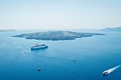 Ferry and boats travel along the coast, Fira, Santorini, Greece