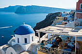 View of the Aegean sea and buildings on the hillside above, Oia, Santorini, Greece