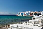 Seafront taverna tables in the Little Venice area, Mykonos Town, Mykonos, Cyclades, Greek Islands, Greece